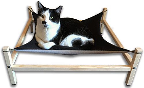 treat your feline body to the comfort and support it deserves with this cat hammock the soft fleece hammock conforms to all body and fur